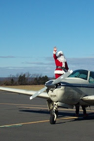 Santa Waves to Fans