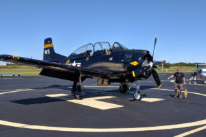 1957 T-28 returns to Princeton Airport from an air show